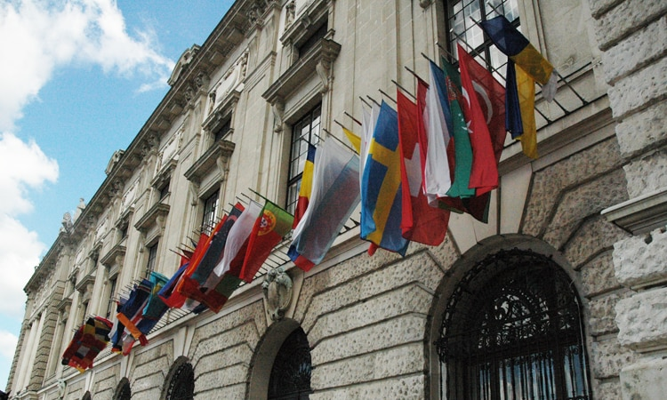 Flags of the OSCE participating States outside the Hofburg Congress Center in Vienna, Austria (USOSCE/Colin Peters)