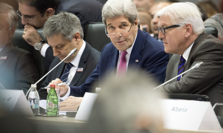 U.S. Secretary of State John Kerry speaks to Germany's Minister for Foreign Affairs Frank-Walter Steinmeier prior to the opening session of the 2015 OSCE Ministerial Council, Belgrade, Serbia, Decemeber 3, 2015. (USOSCE/Colin Peters)