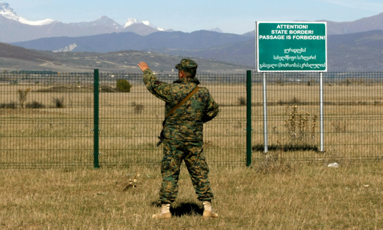 A Georgian police officer guards the administrative boundary line with Georgia's province of South Ossetia. (AP)