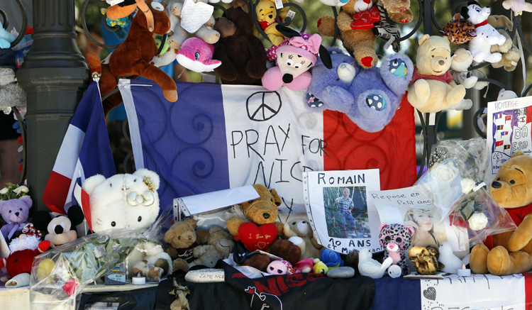 Dolls and teddy bears are placed at a memorial in a gazebo on the Promenade des Anglais in Nice, southern France, Wednesday, July 20, 2016. (AP images)