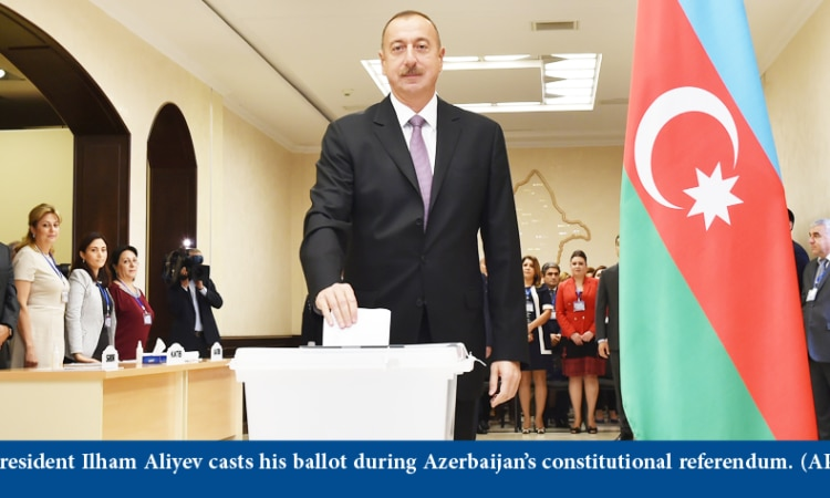 Azerbaijani President Ilham Aliyev casts his ballot at a polling station during a referendum in Baku, Azerbaijan on Monday, Sept. 26, 2016.
