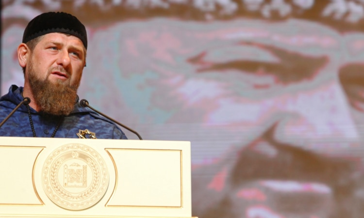 Chechnya's regional leader Ramzan Kadyrov speaks in front of a portrait of his late father, Akhmad Kadyrov, 2017. (AP image)