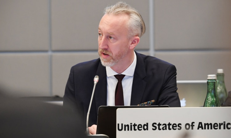 USOSCE Political Officer Dustin DeGrande delivers remarks at the closing session of the 1st Preparatory Meeting of the 26th OSCE Economic and Environmental Forum, Vienna, Austria, January 23, 2018. (USOSCE/Colin Peters)