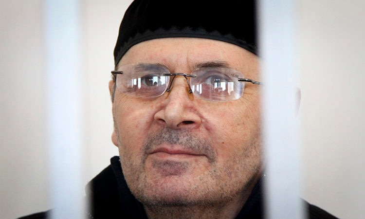 Oyub Titiyev, head of regional branch of Russian human rights group Memorial, attends a court hearing in Grozny, Russia, Tuesday, March 6, 2018. (AP Photo/Musa Sadulayev)