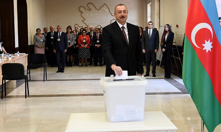 Azerbaijan President Ilham Aliyev casts a ballot at a polling station in Baku during the 2018 presidential election, April 11, 2018. (AP Photo)