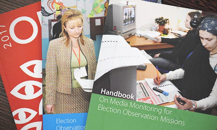 Selection of ODIHR publications, including its Handbook on Media Monitoring for Election Observation Missions. (USOSCE/Colin Peters)
