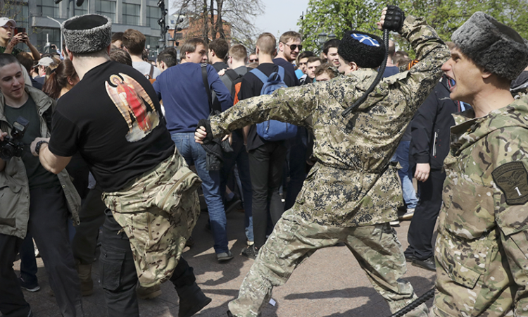 "The ""National Liberation"" movement clashes with protesters during a demonstration against President Vladimir Putin in Pushkin Square in Moscow, Russia, Saturday, May 5, 2018. (AP Photo)"