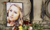 A portrait of murdered journalist Viktoria Marinova at the Liberty Monument in Ruse, Bulgaria, Oct. 9, 2018. (AP Photo/Filip Dvorski)