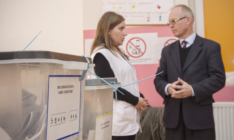 Ambassador Jan Braathu, Head of the OSCE Mission in Kosovo, visits a polling station during a local election in 2017. (OSCE/Yllka Fetahaj)