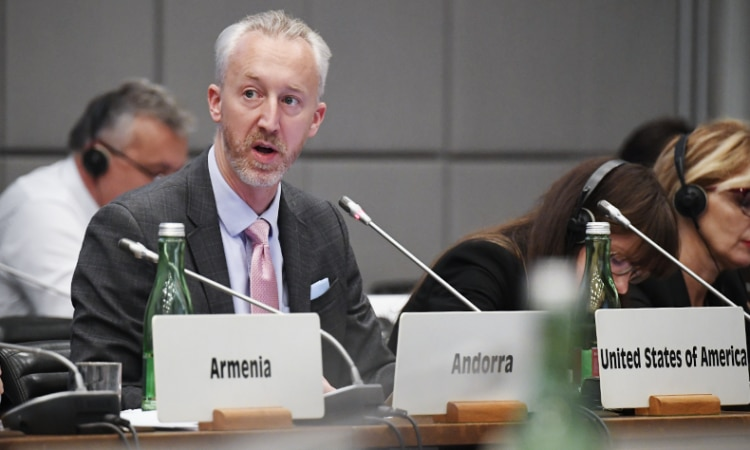 USOSCE Political Officer Dustin DeGrande delivering the U.S. closing statement at the 2018 OSCE Economic and Environmental Dimension Implementation Meeting, Vienna, Austria, October 16, 2018. (USOSCE/Colin Peters)