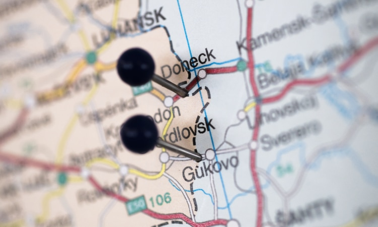 A close-up of pins in a map showing the locations of the two border checkpoints on the Russia-Ukraine border to which Russia limits OSCE observation of its border with Ukraine. (USOSCE/Colin Peters)