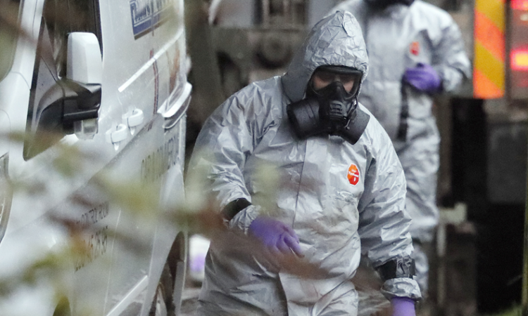 Military forces working on a van in Winterslow, England, as investigations continue into the nerve-agent poisoning of Sergei Skripal and his daughter Yulia, in Salisbury, England, on Sunday March 4, 2018. (AP Photo)